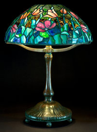 A TIFFANY STUDIOS PATINATED BRONZE LAMP WITH TULIP GLASS SHADE Tiffany Studios