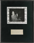 "Autographs:Celebrities, Cole Porter Signature on a page 4"" x 1.5"". Handsomely matted and framed with a music score background and a photograph of Po..."