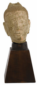 Asian:Other, A Thai Stone Head of Buddha. Unknown maker, Thailand. 15th century,Ayuthya Period. Stone. Unmarked. 10.5 inches high x 6....