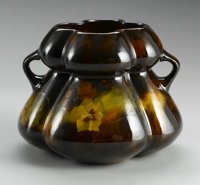 AN AMERICAN POTTERY VASE Weller Aurelian, 1898-1910  The lobed form with applied handles decorated with pansies on the h...