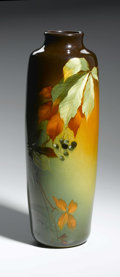 Ceramics & Porcelain, American:Modern  (1900 1949)  , AN AMERICAN POTTERY VASE. Weller Louwelsa, Early 20th Century. Thetall baluster form decorated with a leafy branch and pe...