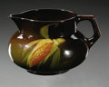 Ceramics & Porcelain, American:Modern  (1900 1949)  , AN AMERICAN POTTERY PITCHER. Roseville, 1940sR. A Rozaneware pitcher decorated with a corn cob on the high gloss brown...