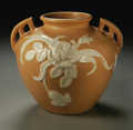 Ceramics & Porcelain, American:Modern  (1900 1949)  , AN AMERICAN POTTERY VASE. Weller. In Cameo pattern, thebalustar form with applied handles molded with a floral spray ...