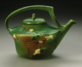 Ceramics & Porcelain, American:Modern  (1900 1949)  , AN AMERICAN POTTERY TEA POT. Roseville, 1946. The Snowberrypattern shouldered cylindrical forM with applied handle an...