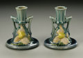 Ceramics & Porcelain, American:Modern  (1900 1949)  , A PAIR OF AMERICAN POTTERY CANDLESTICKS. Roseville, 1944. InClematis pattern, each molded, waisted form with applied ...(Total: 2 Items)