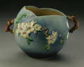 Ceramics & Porcelain, American:Modern  (1900 1949)  , AN AMERICAN POTTERY VASE. Roseville, c. 1950. The Apple Blossom pattern vase of spherical shape with branch handles an...