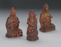 Asian:Chinese, GROUP OF THREE CHINESE AMBERINE GUANYIN. Group of three Chineseamberine Guanyin; one pair seated in a position of royal e...