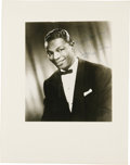 "Movie/TV Memorabilia:Autographs and Signed Items, Nat King Cole Signed Photo. A b&w 8"" x 10"" portrait of Cole,inscribed and signed by him in blue ink. Matted to an overall s..."