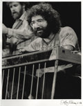 "Music Memorabilia:Photos, Jerry Garcia photo Signed by Artist. A very nice 11"" x 14"" b&wphoto of the late Grateful Dead frontman, signed by world-fa..."
