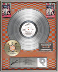 "Music Memorabilia:Awards, TLC ""Ain't 2 Proud 2 Beg"" Platinum Album Award. Presented to JuneColbert to commemorate the sale of one million copies of t..."