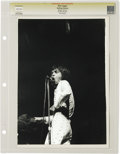 "Music Memorabilia:Photos, Mick Jagger Vintage Photo. A b&w 11"" x 14"" photo of Jaggerstrutting his stuff onstage. Graded Very Fine by CGC. From the..."