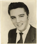 "Music Memorabilia:Autographs and Signed Items, Signed Photo of Elvis Presley. A great b&w 8"" x 10"" photo of ayoung Elvis, inscribed ""Lovingly"" and signed by Presley in bl..."
