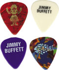 "Music Memorabilia:Memorabilia, Jimmy Buffet Guitar Picks Group of Four. Here's a group that'llthrill ""parrotheads"" everywhere: a set of awesome picks from...(Total: 4 )"