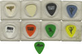 Music Memorabilia:Memorabilia, Metal and Hard Rock Guitar Pick Group of Nine. Whether you've gotyour own axe or prefer the air guitar, you'll play better ...(Total: 9 )