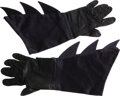 "Movie/TV Memorabilia:Costumes, Costume Gloves Worn by Adam West on ""Batman."" This pair of darkblue satin batgloves with black leather palms was worn by Ad..."