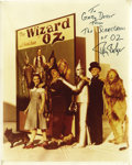 "Movie/TV Memorabilia:Autographs and Signed Items, Ray Bolger Signed Photo. Features a color 8"" x 10"" cast photo from""The Wizard of Oz"" signed by Ray Bolger. In Excellent con..."