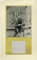 Movie/TV Memorabilia:Autographs and Signed Items, Errol Flynn Signature with Photo. An autograph album leaf signed by the swashbuckling action hero in blue ink, matted along ...