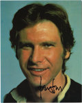 "Movie/TV Memorabilia:Autographs and Signed Items, Harrison Ford Signed Photo. A color 8"" x 10"" of Ford as Han Solo, signed by the actor in black marker, and in Excellent con..."