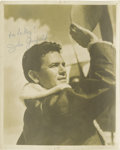 """Movie/TV Memorabilia:Autographs and Signed Items, John Garfield Signed Photo. A great b&w 8"""" x 10"""" photo ofGarfield in a bomber jacket and standing by a plane, inscribed""""Fo..."""