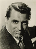 "Movie/TV Memorabilia:Autographs and Signed Items, Cary Grant Signed Photo. A b&w 6"" x 8"" portrait of Grant,signed by him in black ink. Matted to an overall size of 11"" x14""..."