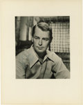 "Movie/TV Memorabilia:Autographs and Signed Items, Alan Ladd Signed Photo. A b&w 8"" x 10"" portrait of the Shane star, inscribed and signed by him in blue ink. Matted to an..."