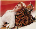 "Movie/TV Memorabilia:Photos, Glamorous Kim Novak Portraits. A gorgeous 15"" x 19"" b&wportrait of Novak and a color 16"" x 13"" photo of her lying on atige..."