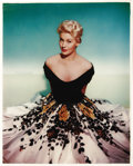 "Movie/TV Memorabilia:Photos, Beautiful Color Portrait of Kim Novak. A great color 13"" x 16""portrait of Novak in a beautiful black-and-white gown with fl..."