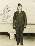 "Movie/TV Memorabilia:Autographs and Signed Items, Mickey Rooney Signed Photo. A b&w 8"" x 10"" photo of Rooney in uniform, inscribed and signed by him in black ink. Matted to a..."
