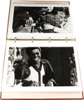 "Movie/TV Memorabilia:Photos, Photos of Sammy in Japan. A red photo album with 40 great b&w14"" x 11"" shots of Sammy singing, dining, smoking like a chimn..."