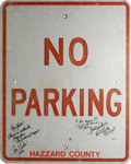 "Movie/TV Memorabilia:Props, Cast Signed ""No Parking"" Sign from ""Dukes of Hazzard."" This 24"" x30"" ""No Parking -- Hazzard County"" prop road sign was used..."