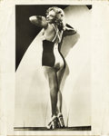 "Movie/TV Memorabilia:Photos, Marilyn Monroe Swimsuit Photo. A stunning vintage 8"" x 10"" b&w cheesecake photo of Marilyn in a bathing suit, with attached ..."