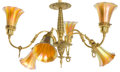 Decorative Arts, American:Lamps & Lighting, AN AMERICAN BRASS SIX-LIGHT CHANDELIER WITH IRIDESCENT GLASS SHADES . Maker of chandelier unknown. Glass attributed to Steub... (Total: 7 Items)