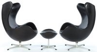 A PAIR OF JACOBSEN LEATHER EGG CHAIRS AND OTTOMAN Designed by Arne Jacobsen (Dan