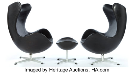 A PAIR OF JACOBSEN LEATHER EGG CHAIRS AND OTTOMAN  Designed by Arne Jacobsen (Danish, 1902-1971) Manufactured ... (Total: 3 Items)