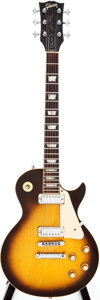 Musical Instruments:Electric Guitars, 1976 Gibson Les Paul Deluxe Sunburst Solid Body Electric Guitar,Serial # 00134621....
