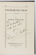 Books:Mystery & Detective Fiction, Dennis Wheatley. INSCRIBED. Uncharted Seas. Hutchinson, [n.d.]. Signed and inscribed by the author. Rubbing...