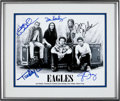 Music Memorabilia:Autographs and Signed Items, Eagles Signed and Framed Photo. ...