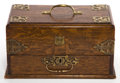 Decorative Arts, British:Other , AN ENGLISH WOOD AND BRASS MECHANICAL WRITING BOX . 19th century .6-1/2 inches high x 11-3/4 inches long x 7 inches wide (16...