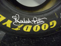 Movie/TV Memorabilia:Autographs and Signed Items, Race Tire Signed by Richard Petty. Benefitting Mercury One . ...