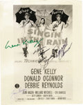 "Movie/TV Memorabilia:Autographs and Signed Items, ""Singin' In the Rain"" Cast Signed Photo. A b&w 8"" x 10"" promo photo of the movie's poster, signed by by stars Gene Kelly in ... (Total: 1 Item)"