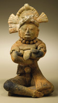 Pre-Columbian:Ceramics, Male Figure Seated Cross-legged with Folded Arms. Maya. A.D. 550 -900. Ceramic, traces of paint. Height 7 1/4 in. Width 4 ...