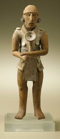 Pre-Columbian:Ceramics, Standing Male Figure with Left Hand on Right Wrist. Maya, Jaina.A.D. 550 - 900. Ceramic, traces of original paint. Height 8...