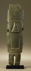 Pre-Columbian:Stone, Standing Dignitary with Bird-form Headdress. Guerrero. 200 B.C. -A.D. 600. Green stone (serpentine?) with traces of red pig...