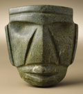 Pre-Columbian:Stone, Large Stylized Head. Mezcala. 300 B.C. - A.D. 300. Green stone.Height 4 7/8 in. Width 4 3/8 in.. Within the overall trap...