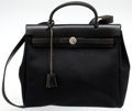 Luxury Accessories:Bags, Heritage Vintage: Hermes Black Canvas and Leather Her MMBag. ...
