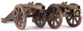 Decorative Arts, Continental:Other , A PAIR OF CONTINENTAL PATINATED BRONZE AND WOOD DECORATIVE CANNONS. 19th century . 30 inches long (76.2 cm). ... (Total: 2 Items)