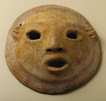 Pre-Columbian:Ceramics, Circular Face Mask with Ears. Tlatilco. 1100 - 900 B.C.. Ceramic,traces of paint. Height 5 1/4 in. Width 5 1/4 in.. The ...