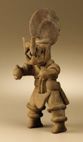 Pre-Columbian:Ceramics, Masked Dancer. Colima. 200 B.C. - A.D. 200. Buff ceramic. Height 101/2 in. Width 4 in.. A number of Colima figures of thi...