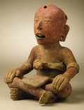 Pre-Columbian:Ceramics, Seated Cross-legged Figure. Veracruz, central area. A.D. 300 - 700.Ceramic, traces of paint. Height 7 3/4 in. Width 6 in....