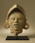 Pre-Columbian:Ceramics, Head of Eagle Warrior. Veracruz. A.D. 300 - 700. Ceramic, traces ofred paint. Height 11 1/2 in. Width 9 1/4 in.. This l...